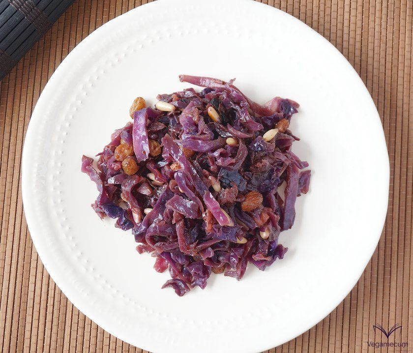Aerial shot of sweet and sour red cabbage with apple, raisins and pine nuts